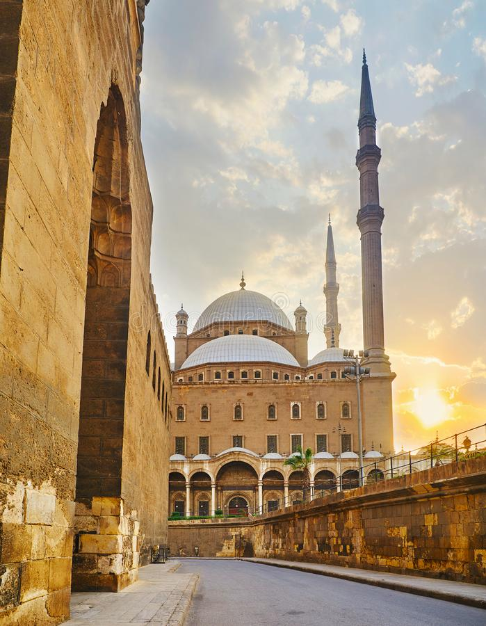 The streets of Cairo Citadel, Egypt. Walking the narrow medieval streets of Saladin Citadel with a view on stone walls and the great Alabaster Mosque with tall stock photo
