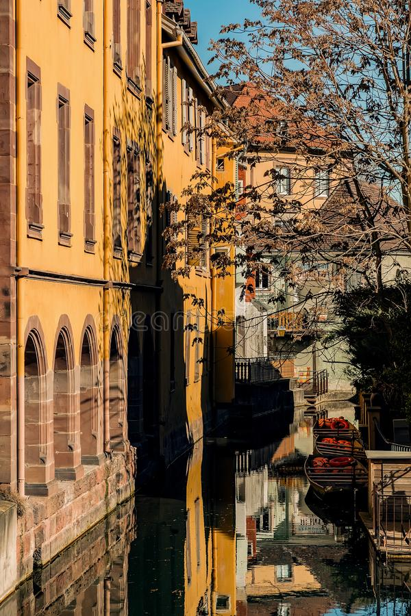 Streets of Colmar, Grand Est Alsace in spring. Colmar, Alsace, France, February 24, 2019. Cozy and beautiful streets of the French city on a sunny spring warm royalty free stock photo