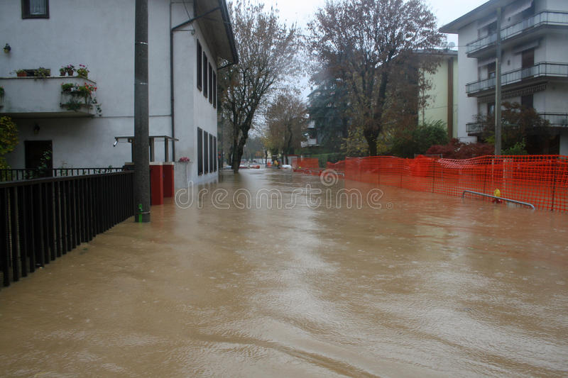 Streets and courtyards of the House invaded by mud during a flooding 8. Streets and courtyards of the House invaded by mud during a flooding of the River 8 stock photo