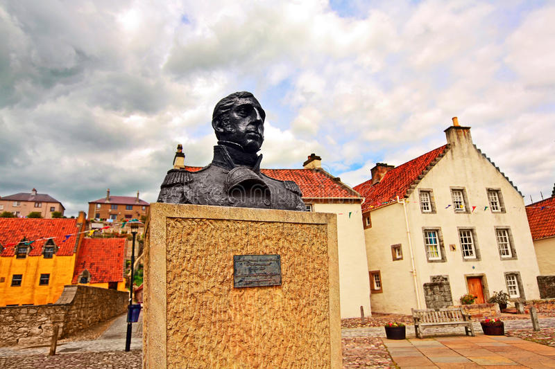 Streets of Culross, Fife, Scotland. Culross is a former royal burgh in Fife, Scotland founded in 6th century. A bust of Thomas Cochrane stock photo