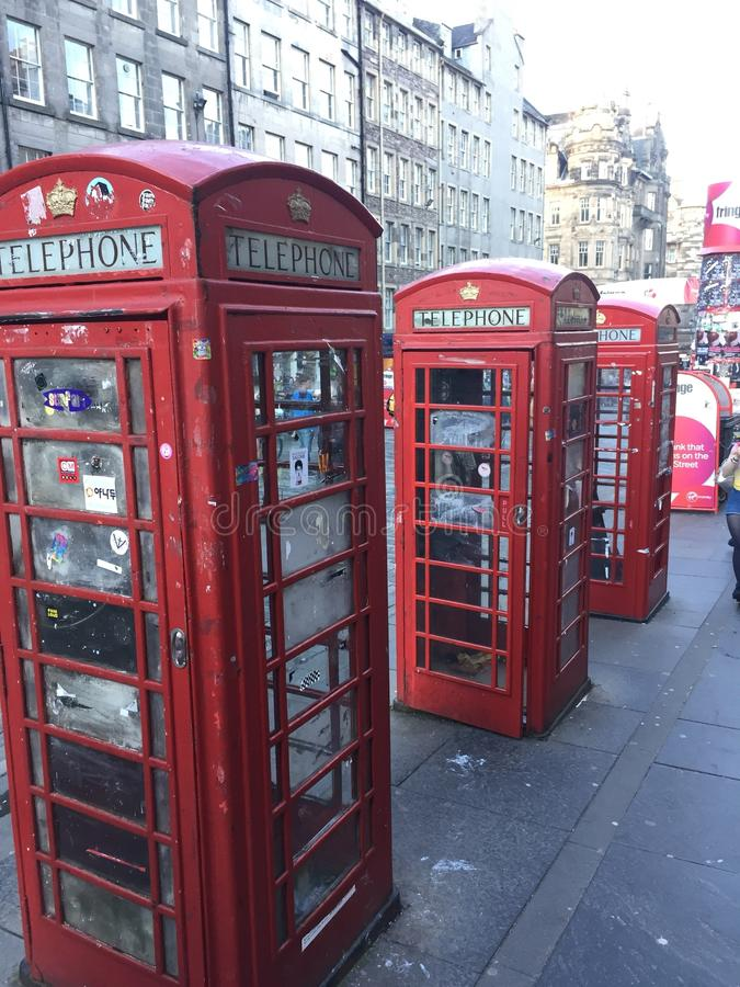 Red telephone booths in Edinburgh. Streets of Edinburgh telephone booths line stock photography