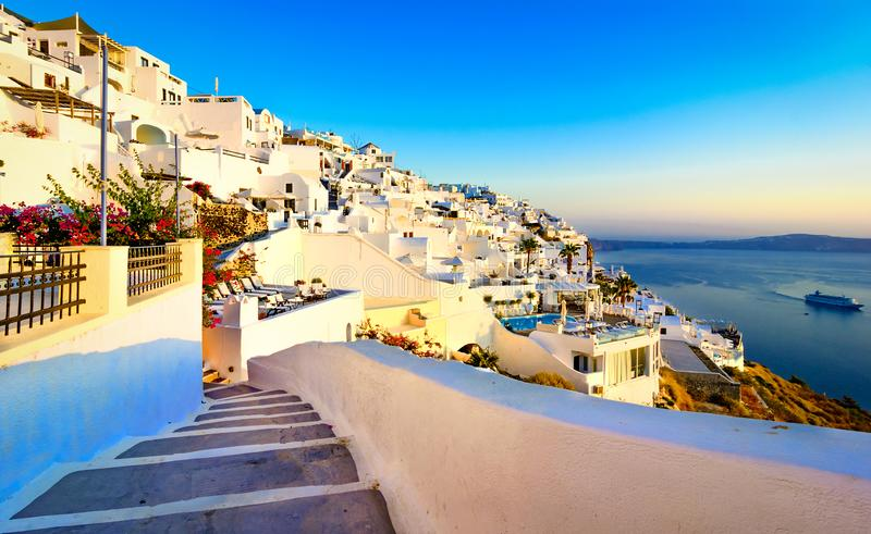 Fira, Santorini island, Greece. Traditional and famous white houses over the Caldera, Aegean sea. Streets of Fira, Santorini island, Greece. Traditional and royalty free stock image