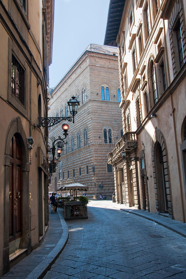 Streets of Florence, Italy. Narrow cobblestone street and mobile vegetables stand in Florence, Italy stock photography