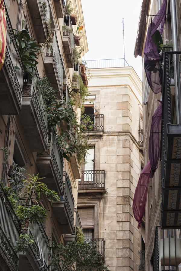 On the streets of the Gothic Quarter in Barcelona. BARCELONA, SPAIN - JULY 13, 2013: On the streets of the Gothic Quarter in Barcelona stock photo