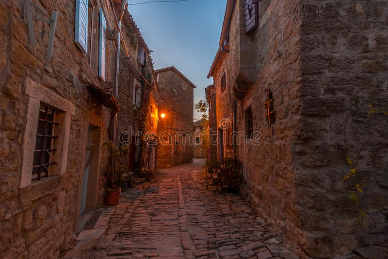 Streets of Groznjan at late afternoon. Street of Old Town Groznjan, Istria, Croatia, photographed with my Nikon D750 at Winter afternoon and blue Hour stock photography