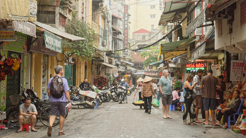 Streets of Hanoi. A view of a street in Hanoi, Vietnam, with pedestrians, commuters, farmers and tourists stock images