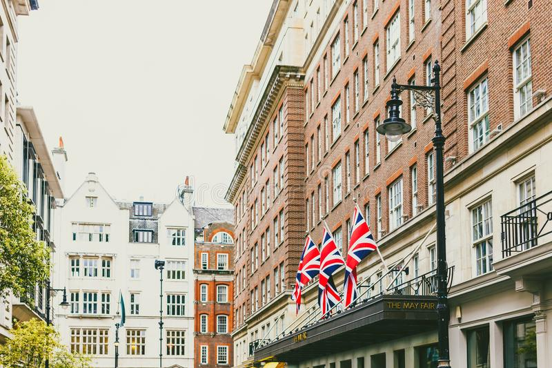 Streets with historical buildings in Mayfair, an affluent are of. LONDON, UNITED KINGDOM - August 2nd, 2014: beautiful streets with historical buildings in royalty free stock photography