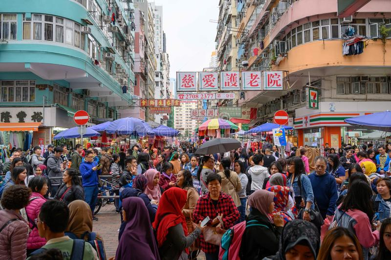 Crowded streets in Kowloon, Hong Kong. Crowds and chinese ideographs in a street in Hong Kong. stock images