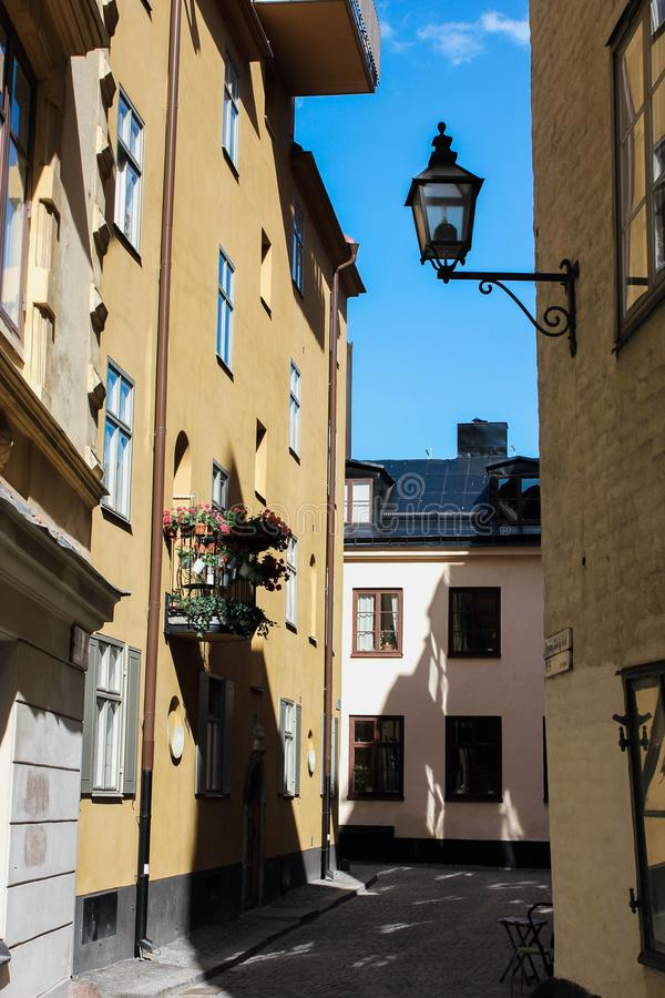 Streets and houses of sunny summer Stockholm`s Old Town Gamla Stan in Stockholm, Sweden. Stockholm, Sweden - June 16, 2018: Streets and houses of sunny summer royalty free stock images