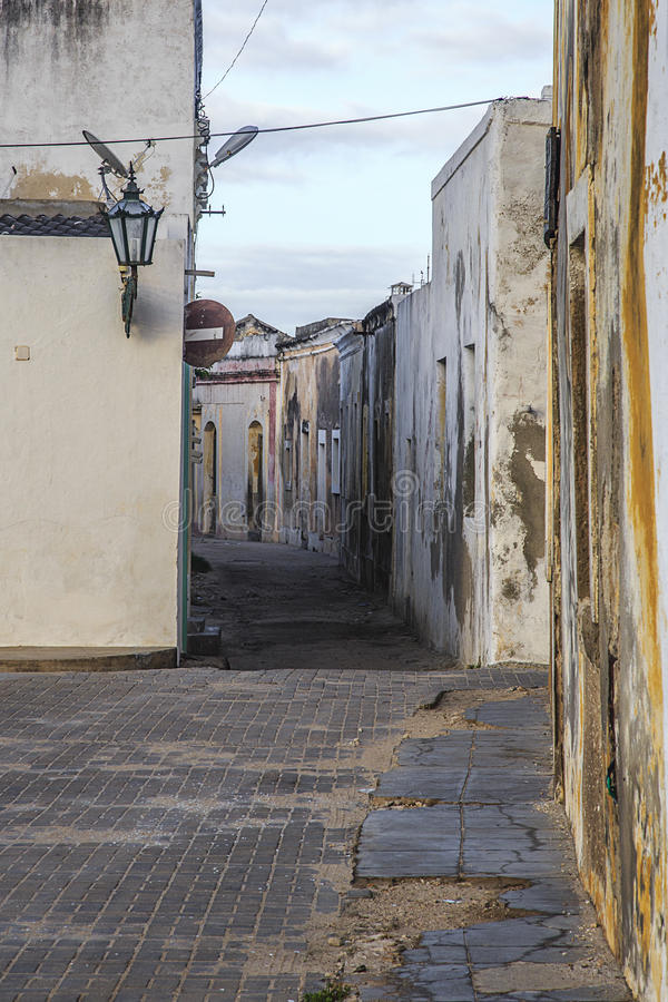 Streets of Island of mozambique. The Island of Mozambique (Portuguese: Ilha de Moçambique) lies off northern Mozambique, between the Mozambique Channel and stock photography
