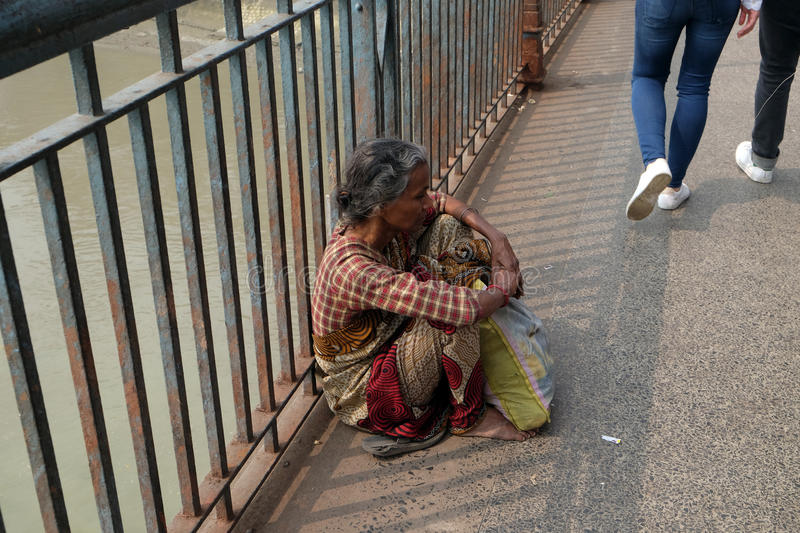 Streets of Kolkata. Beggars. Beggars are the most disadvantaged castes living in the streets, 42% of India falls below the international poverty line of $1.25 a royalty free stock photo
