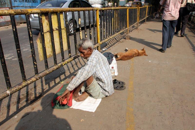 Streets of Kolkata. Beggars. Streets of Kolkata. Thousands of beggars are the most disadvantaged castes living in the streets on November 28, 2012 in Kolkata royalty free stock photo