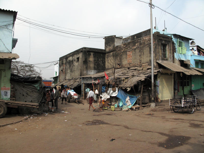 Streets of Kolkata. Poor Indian family living in a makeshift shack by the side of the road stock image
