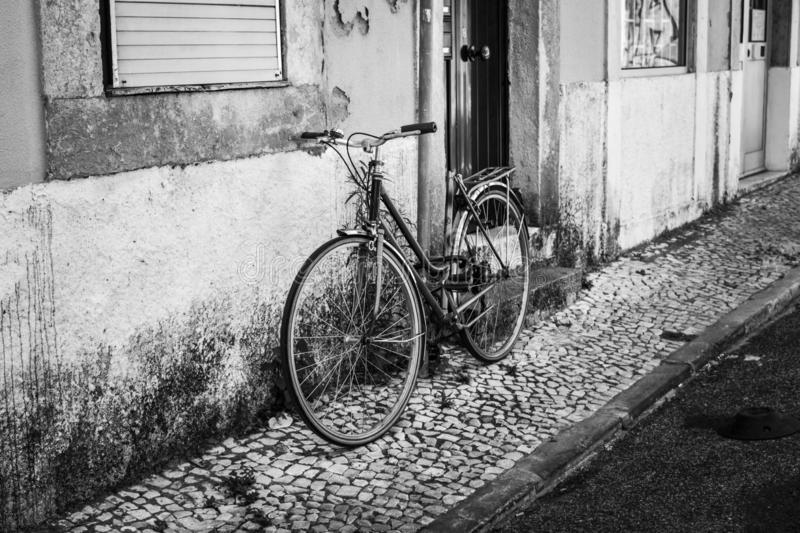 Streets of Lisbon. Old bicycle. Black and white photo. B&W. Street photography royalty free stock photos