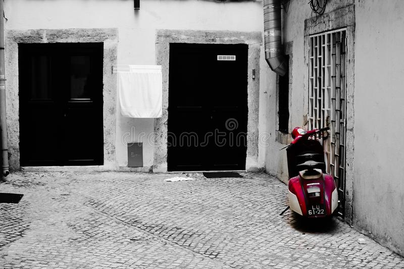 Streets of Lisbon.  Old scooter.  Black white and red.  Lisbon.  Portugal stock photo