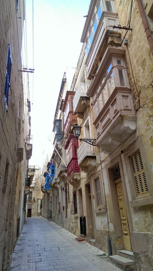 Streets of Malta. Gallarija traditional bow window balconies in Birgu, Malta royalty free stock image