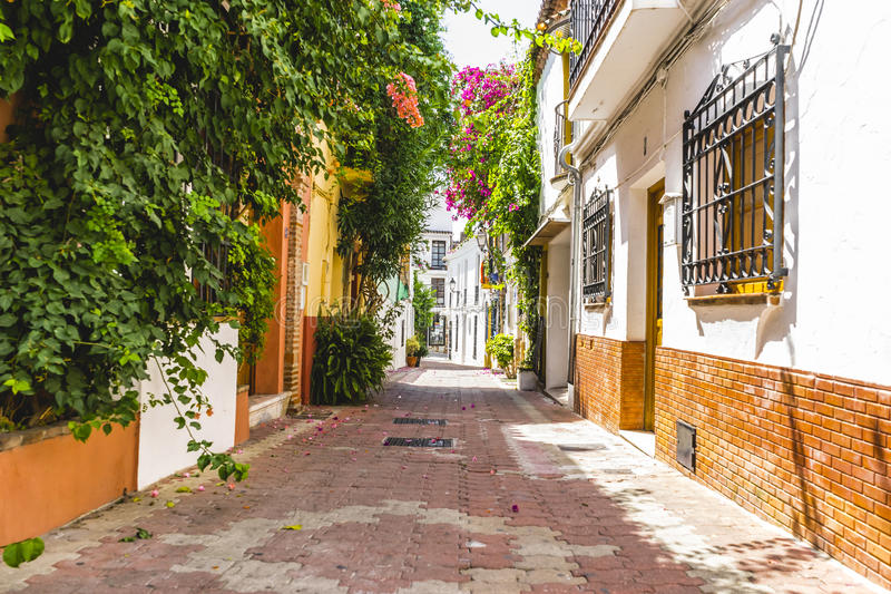 Streets of Marbella in Spain with flowers and plants on the faca. De,tradicional royalty free stock image