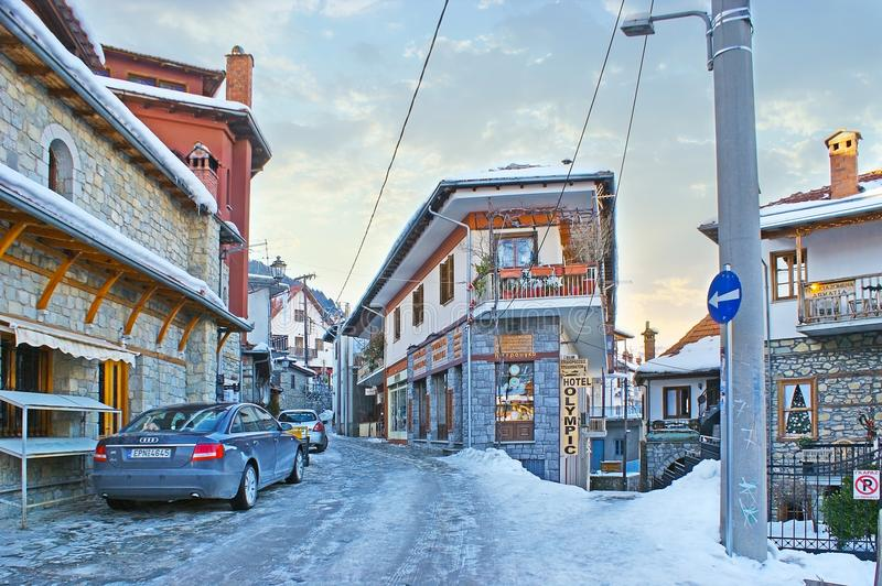 The streets of Metsovo. METSOVO, GREECE - JANUARY 2, 2012: The winding street of old town with traditional houses of Epirus region, multiple stores and hotels royalty free stock photos