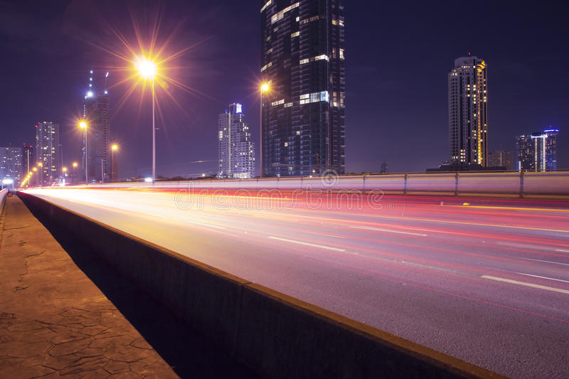 Streets at night. Light in car on city streets at night in Bangkok, Thailand royalty free stock photo
