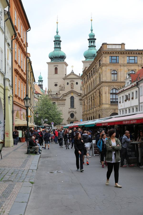 Streets of old Prague with all numerous little shops and crowds of the tourists who are looking for new impressions. stock image