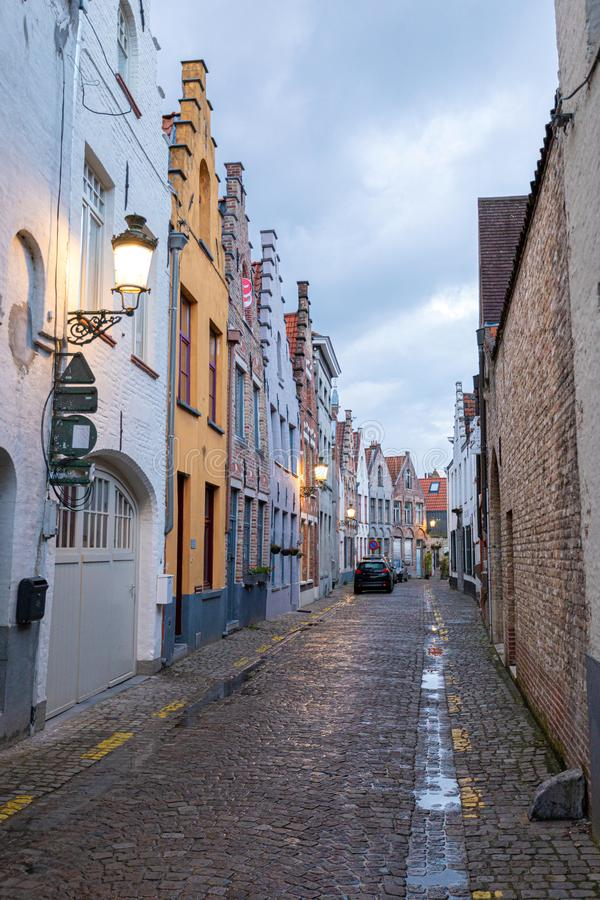 Streets in the old town of Bruges in the evening. Street light royalty free stock photography
