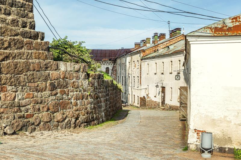 The streets of the old town in the fortress of Vyborg on a bright sunny day stock photos
