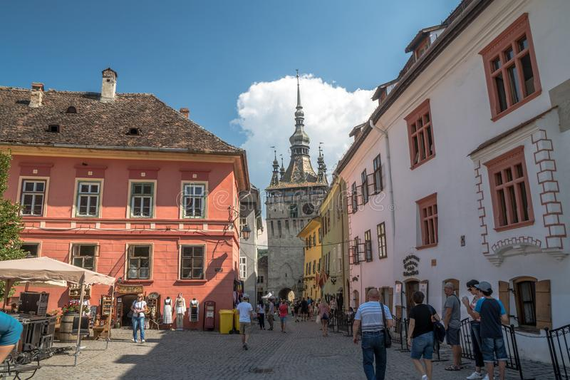 Streets of old town sighisoara with clock tower. stock photo