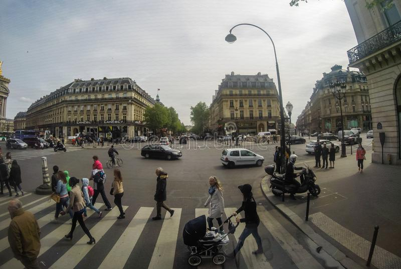 Streets of Paris with pedestrians and traffic.  royalty free stock images