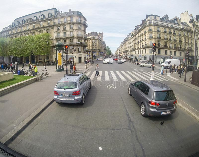 Streets of Paris with pedestrians and traffic.  stock photos