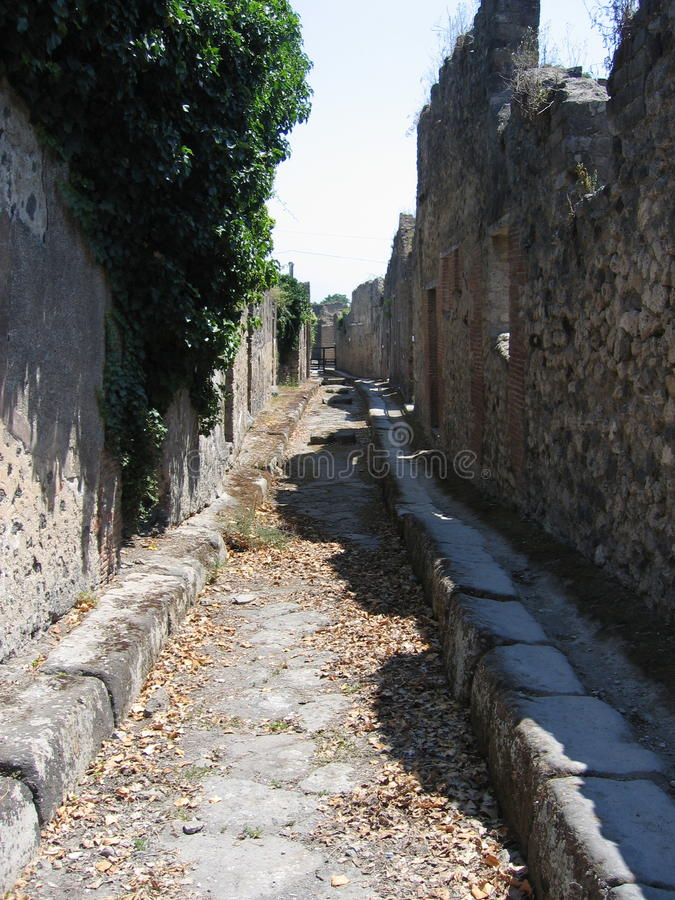 Streets of Pompeii. A paved street in Pompeii. Pompei, Province of Naples, Campania, Italy. Pompeii was an ancient Roman town-city near modern Naples, in the stock image