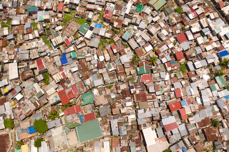 Streets of poor areas in Manila. The roofs of houses and the life of people in the big city. Poor districts of Manila. View from above. Manila, the capital of royalty free stock image