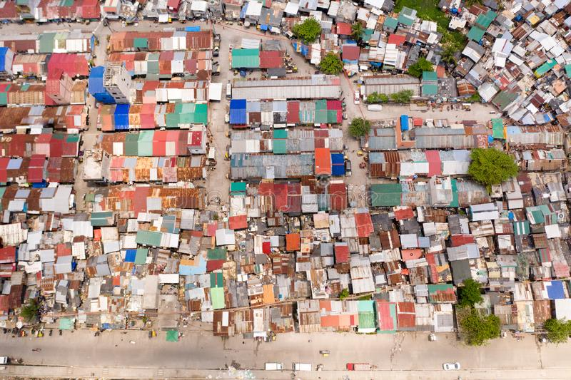 Streets of poor areas in Manila. The roofs of houses and the life of people in the big city. Poor districts of Manila. View from above. Manila, the capital of royalty free stock photography