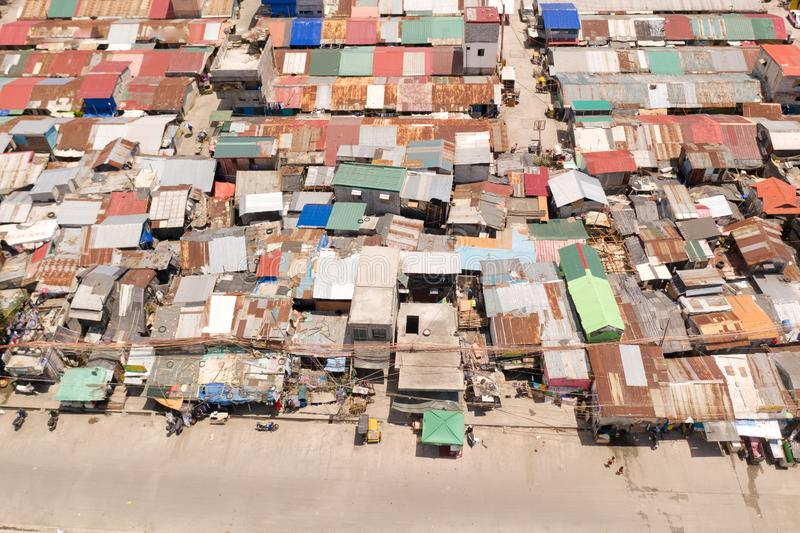 Streets of poor areas in Manila. The roofs of houses and the life of people in the big city. Poor districts of Manila. View from above. Manila, the capital of stock images