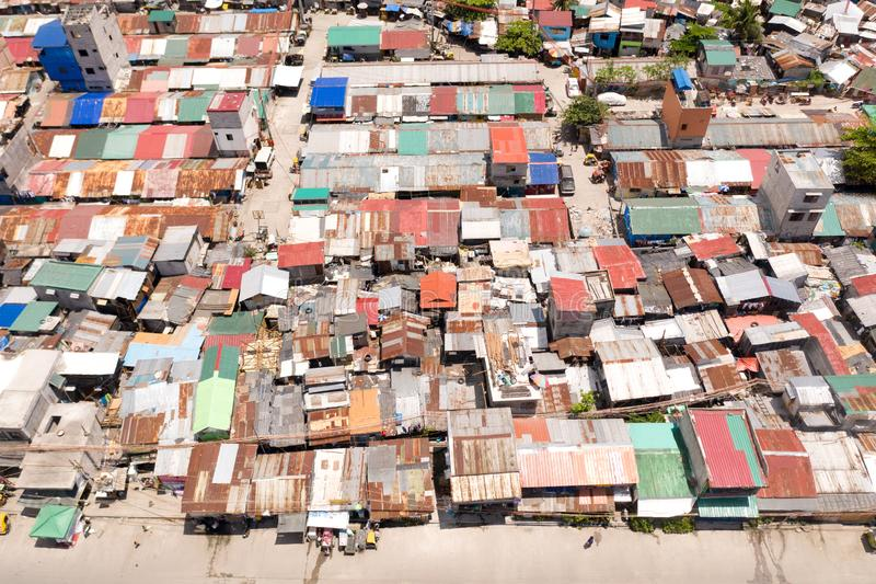 Streets of poor areas in Manila. The roofs of houses and the life of people in the big city. Poor districts of Manila. View from above. Manila, the capital of stock photo