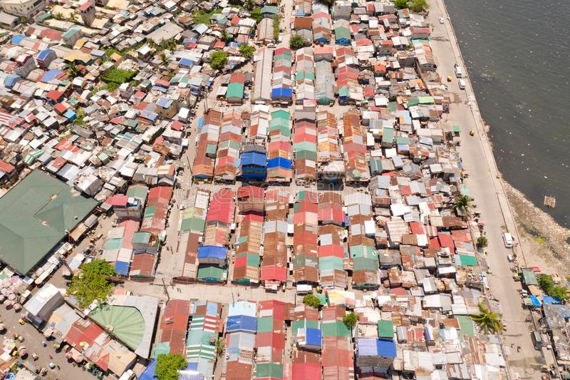Streets of poor areas in Manila. The roofs of houses and the life of people in the big city. Poor districts of Manila, view from. Above. Manila, the capital of stock image