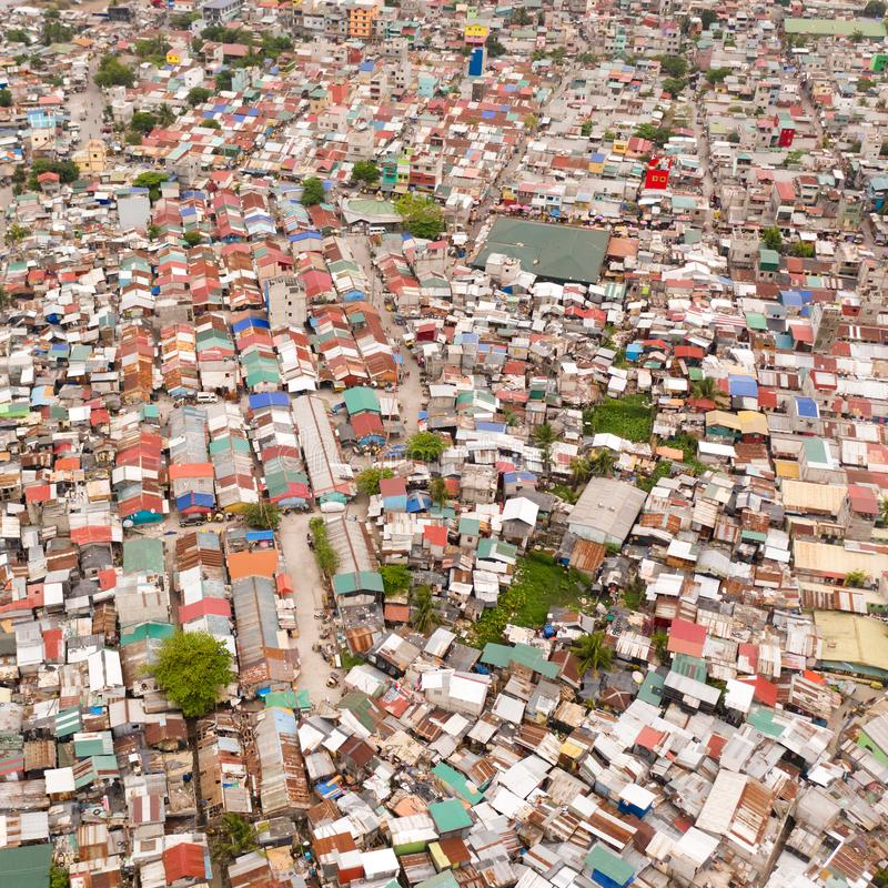 Streets of poor areas in Manila. The roofs of houses and the life of people in the big city. Poor districts of Manila, view from. Above. Manila, the capital of stock images