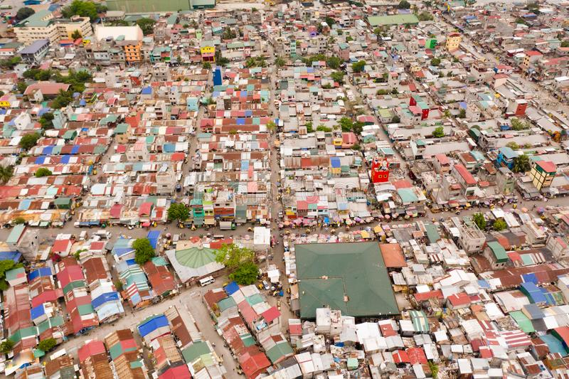 Streets of poor areas in Manila. The roofs of houses and the life of people in the big city. Poor districts of Manila, view from. Above. Manila, the capital of royalty free stock image