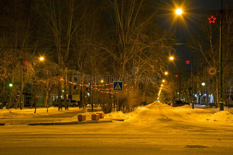 The streets of a provincial town are decorated before Christmas and New Year. Russia. Abakan stock photos