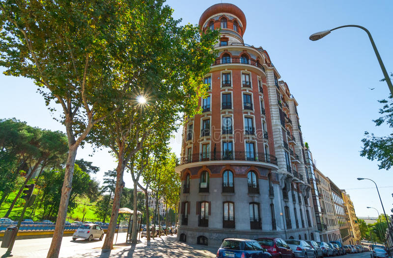 Streets scenes of Madrid. View from corner of Alfonso XII and Velasco Streets. European architecture shown in a rounded corner building. Cars parked on the side royalty free stock photos