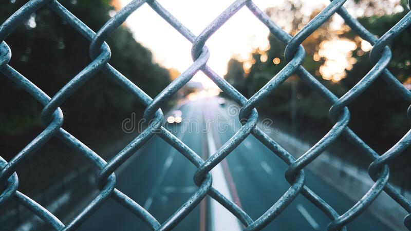 Streets seen through fence royalty free stock image