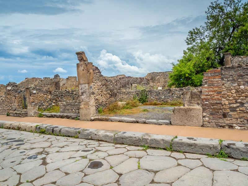 Streets and villas of Pompeii, Italy. World Heritage List. Cobbled street lined with ruined shops and villas in the ancient Roman city of Pompeii, near modern stock photography