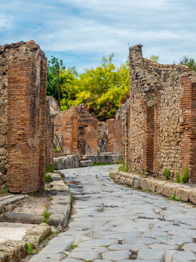 Streets and villas of Pompeii, Italy. World Heritage List. Cobbled street lined with ruined shops and villas in the ancient Roman city of Pompeii, near modern stock images