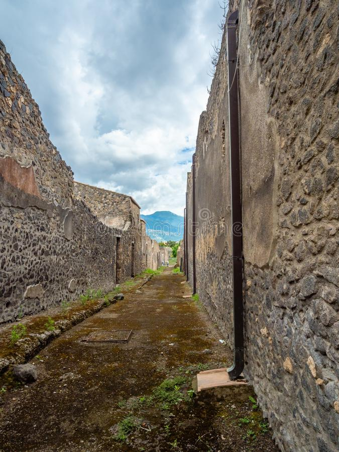 Streets and villas of Pompeii, Italy. World Heritage List. Street in the ancient Roman city of Pompeii, near modern Naples in Italy. Mount Vesuvius with stock image