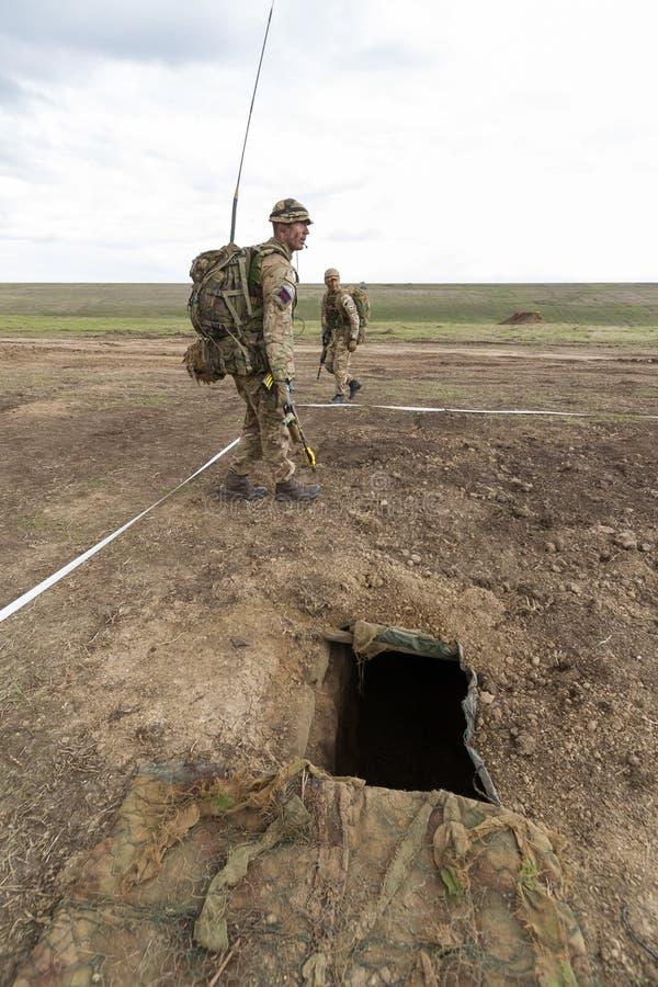 Strefa działań wojennych z żołnierzami zdjęcie stock