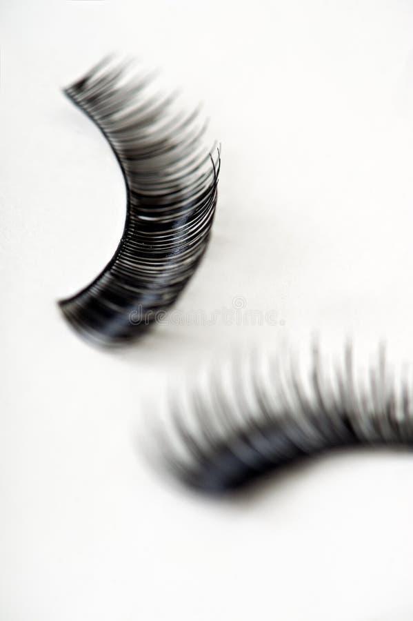 Streifen-falsche Wimpern stockbild