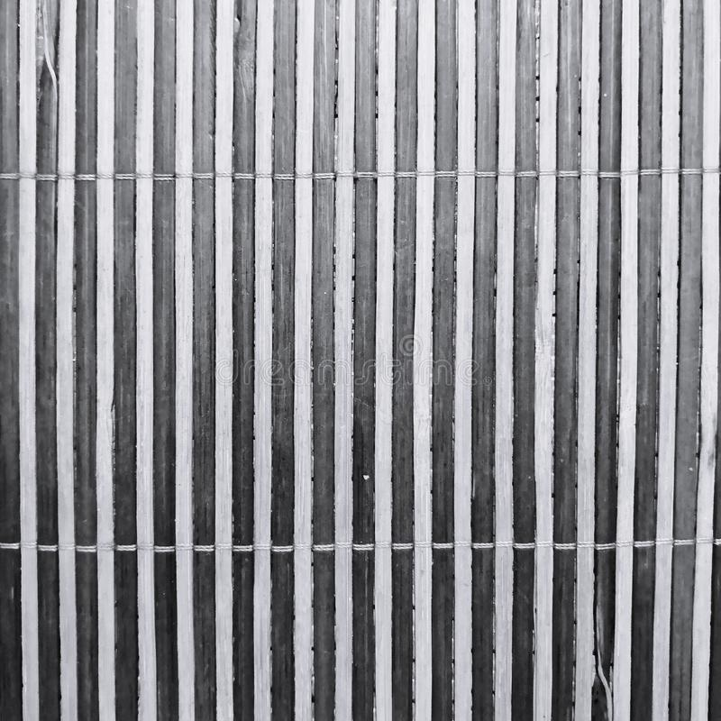 Streifenbeschaffenheit einer Bambusmatte stockfotografie