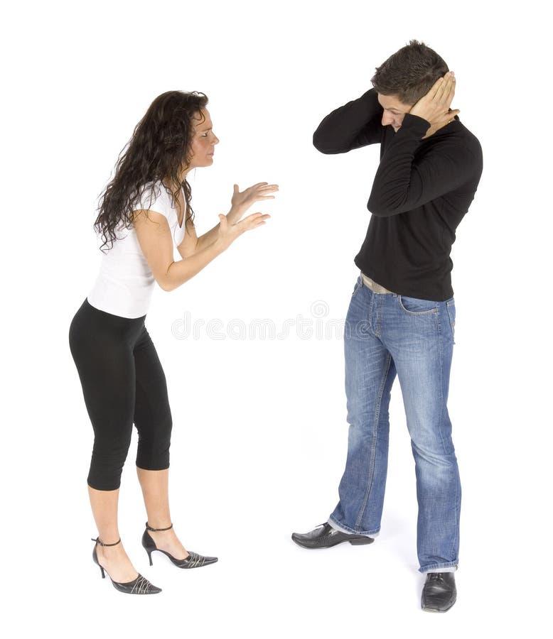 Streit des Paares - Frauenschreien; Mann stoppt Ohren stockbilder