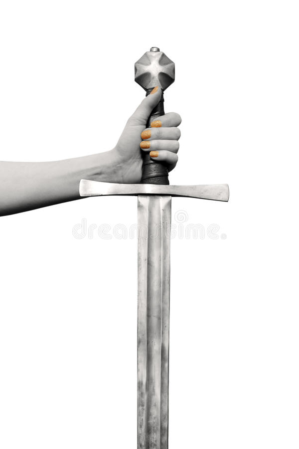 Sword in womans hand. Light sepia view of the womens hand with painted nails orange holding a medieval hand forged sword. Isolated on the white background