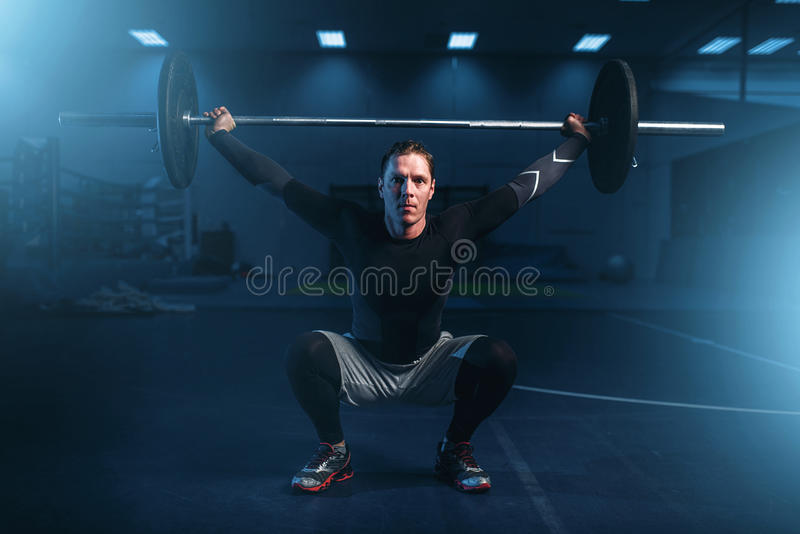 Strength athlete on training, workout with barbell stock photography