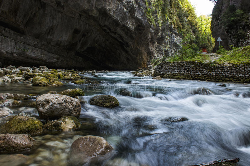 The strength of a mountain river stock image